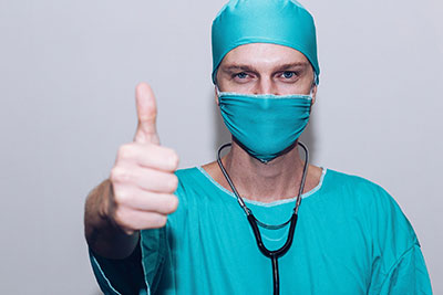 Medical Billing Services in Phoenix, medical staffer with thumbs up.